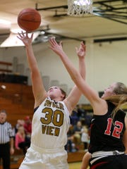 River View sophomore Cydney Whiteus drives to the basket under pressure from Coshocton junior Abby Zimomra Wednesday during the Black Bears' 61-18 victory.