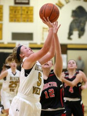 River View junior Mallory Giffin drives to the basket Wednesday under pressure from Coshocton junior Abby Zimomra during the Black Bears' 61-18 victory.