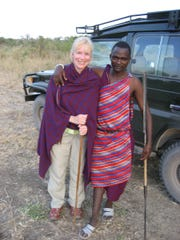 Detroit Free Press reporter Ellen Creager stands with a Masai in Tanzania in 2007. She was travel writer from 2003 to 2016.