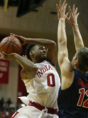 Indiana Hoosiers guard Curtis Jones (0) jumps to pass around defender Liberty Flames forward Brock Gardner (12) during first half action at Indiana University's Assembly Hall, Bloomington, Ind, Saturday, Nov. 19, 2016.