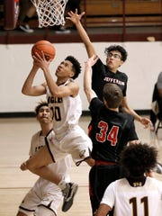 Andress guard Eric Simmons looks for the basket after