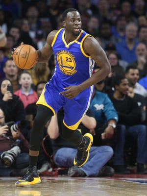 Warriors forward Draymond Green brings the ball upcourt during the fourth period of the Pistons' 119-113 loss to the Warriors Friday at the Palace.