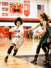 Rajah Fink takes the ball to the basket against York Catholic on Dec. 21.