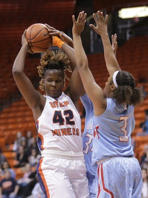 UTEP's Tamara Seda looks to pass after being stopped by Louisiana Tech's Kierra Lang on Thursday at the Don Haskins Center.