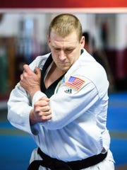 Robert Zerance, 39, a fourth-degree black belt, practices