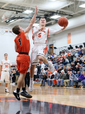 Ridgewood junior Zach Wright drives to the basket Friday during the Generals' 56-28 loss to Strasburg.