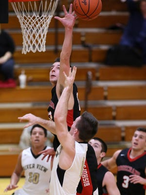 Rosecrans senior Aaron Gehlken blocks a shot from River View junior Jorn Hocter Tuesday during Rosecrans' 66-58 victory. Gehlken scored 28 points.