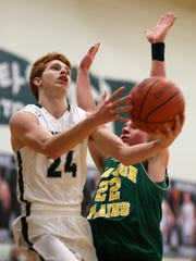 Northridge senior Brandon Estep drives to the basket Monday during the Vikings' 58-47 victory over Madison-Plains.