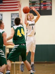 Northridge sophomore Jackson Wilson takes a shot Monday during the Vikings' 58-47 victory over Madison-Plains.