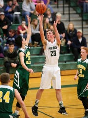 Northridge senior Daniel Hatfield takes a jumper Monday during the Vikings' 58-47 victory over Madison-Plains.