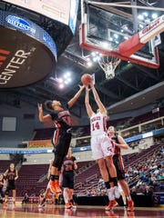 Central York's Teirra Preston (40) and Cumberland Valley's Addison Kirkpatrick (14) battle for a rebound during a District 3 Class 6A girls basketball semifinal game at the Giant Center on Monday, Feb. 27, 2017. Cumberland Valley won 41-32.