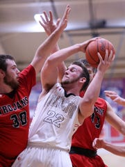 Coshocton senior Jordan Carkin fights for shooting