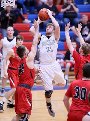 Coshocton senior Andrew Mason pivots for a shot Tuesday during the team's 39-33 district semifinal loss to Tusky Valley.
