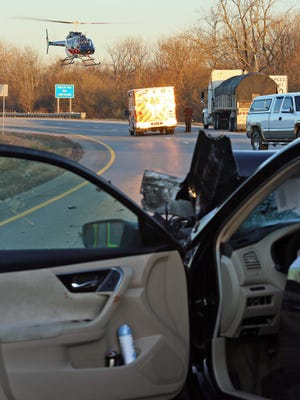 A medical helicopter leaves the scene of a crash on Ohio 16 near Marne Road Wednesday with the drive of a car that rearended a semi trailer.