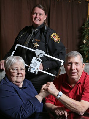 Barbara and Rod Moore are participating in Project Lifesaver with Licking County Sheriff's Office Deputy Karen Dunlap. Rod wears a watch-shaped device acting as a radio transmitter that allows him to safely live at home. Deputy Dunlap, who has over 60 clients, can use the radio receiver she is holding to locate clients with dementia, autism, and other conditions or disorders who might wander from home.