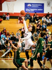 Dover's Rajah Fink (33) attempts a layup against York Catholic last season.