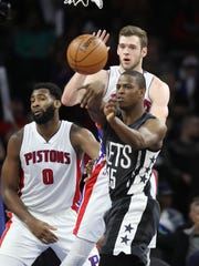 Jon Leuer defends Nets guard Isaiah Whitehead, March 30, 2017 at the Palace.