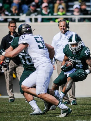 MSU RB Gerald Holmes runs the ball during the 2017 Green & White football game, Saturday, April 1, 2017, at Spartan Stadium in East Lansing.