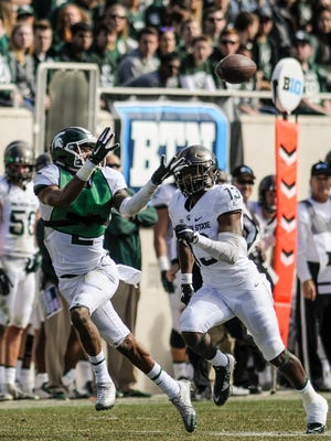 MSU's Justin Layne snags a pass against Vayante Copeland good for a first down Sat., April 1, 2017, during the  Green & White football game at Spartan Stadium in East Lansing.