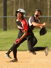 Coshocton's Amia Woods pauses between second and third to watch the ball Tuesday during the team's 8-5 loss to Tusky Central Catholic.