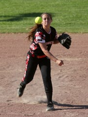 Coshocton sophomore Riley Conkle fields the ball to
