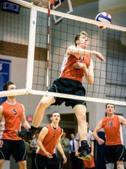 Central York's Braden Richard (11) attempts a kill against Northeastern in the YAIAA boys volleyball championship game at Dallastown on Tuesday, May 16, 2017.