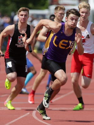 Hunter Biddle takes off with the baton on the anchor leg of Lexington's state champion 4x400 relay.