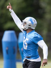 Lions tight end Eric Ebron goes through drills during