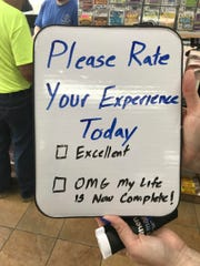 """A rotating """"rate your experience today"""" board allows"""