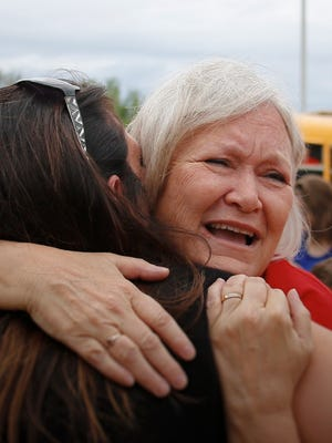 """My whole family went here, and my kids went here, she was my third-grade teacher,"" a tearful Kari Pickell said after hugging third-grade teacher Brenda Munger, right, Friday, the final day of school at East Olive Elementary School.  The school will be permanently closing its doors due to declining enrollment the past few years."