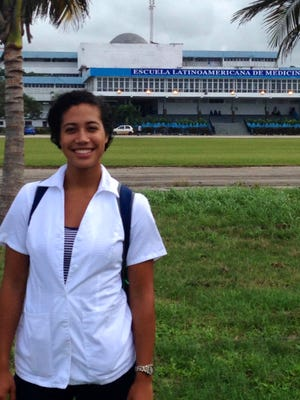 Alexandra Skeeter, 24, stands in front of the Latin American Medical School in Cuba in November 2014.
