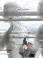 "The sculpture ""Run"" was built using laser-cut slices of stainless steel held together with pins. When viewed from the side, the sculpture seems transparent."