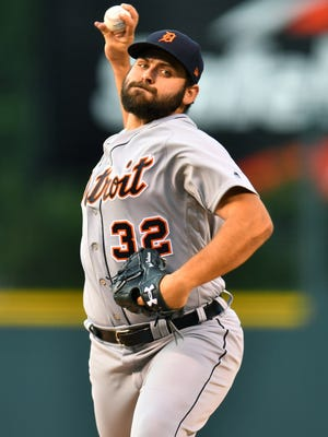 Tigers pitcher Michael Fulmer (32) delivers a pitch in the first inning on Tuesday, Aug. 29, 2017, in Denver.