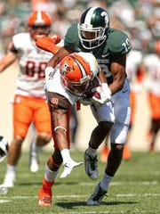 Michigan State cornerback Josh Butler tackles Bowling Green's Teo Redding in the Spartans' 35-10 win on Saturday, Sept. 2, 2017 in East Lansing.