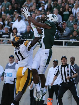 Michigan State's Felton Davis III catches a 6-yard touchdown pass against Iowa's Michael Ojemudia during the first quarter on Saturday, Sept. 30, 2017, at Spartan Stadium in East Lansing.