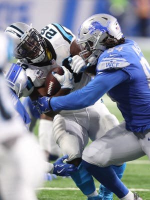 Lions' Ezekiel Ansah tackles the Carolina Panthers' Jonathan Stewart in the second quarter Sunday, Oct. 8, 2017 at Ford Field.