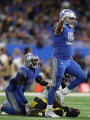 Lions defensive lineman Anthony Zettel celebrates stopping