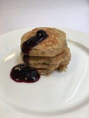 Zucchini bread pancakes with blueberry sauce