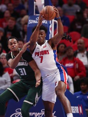 Stanley Johnson rebounds against the Milwaukee Bucks' John Henson in the first quarter of the Pistons' 105-96 win Friday, Nov. 3, 2017 at Little Caesars Arena.
