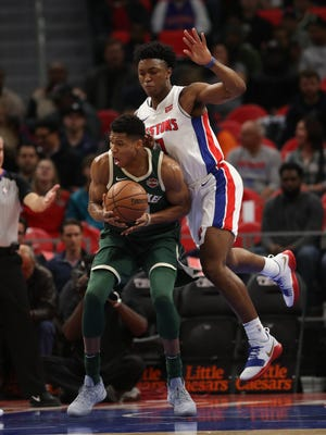 Stanley Johnson defends the Milwaukee Bucks' Giannis Antetokounmpo in the first quarter of the Pistons' 105-96 win Friday, Nov. 3, 2017 at Little Caesars Arena.