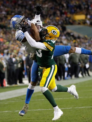 Marvin Jones reaches for his second touchdown, this one over Packers cornerback Damarious Randall in the fourth quarter at Lambeau Field on Monday.