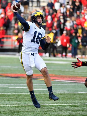 Michigan quarterback Brandon Peters (18) passes the ball against Maryland during the first half of U-M's 35-10 win on Saturday, Nov. 11, 2017, in College Park, Md.