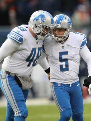 Matt Prater, right, celebrates with Don Muhlbach after kicking the winning field goal in the Detroit Lions' 27-24 win over the Chicago Bears, Nov. 19, 2017 in Chicago.