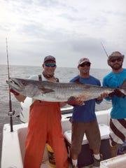 Boat crew members Wes Stork, Justin Darby and Adam