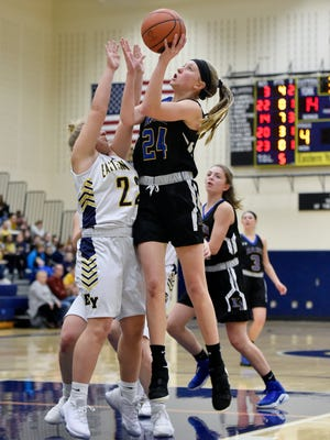 Kennard-Dale's Lexi Kopko shoots against Eastern York's Haley Holtzinger in the second half of a YAIAA girls' basketball game Friday, Jan. 26, 2018, at Eastern York. Kennard-Dale defeated Eastern York 53-42 in double overtime.