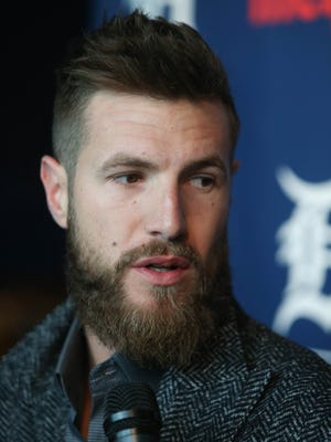 Tigers pitcher Shane Greene talks with reporters during TigerFest at Comerica Park on Saturday.