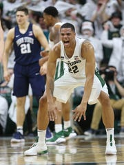 Miles Bridges reacts after hitting a 3-pointer against Penn State on Jan. 31, 2018 at Breslin Center in East Lansing.