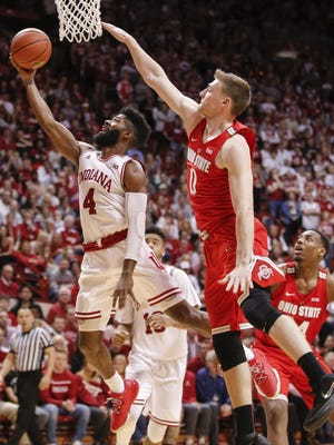 Indiana Hoosiers guard Robert Johnson (4) shoots the ball as Ohio State Buckeyes center Micah Potter (0) defends at Simon Skjodt Assembly Hall in Bloomington, Ind., on Wednesday, Jan. 9, 2018. (Michael Hickey for The Star)