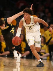 Jordan Poole steals the ball against Iowa during the first half of Michigan's, 77-71, overtime win in the Big Ten tournament March 1, 2018.