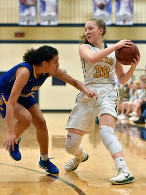 York Catholic's Katy Rader drives against East Allegheny in the first half of a PIAA girls' basketball quarterfinal game Friday, March 16, 2018, at Bald Eagle. York Catholic's season ended with a 77-66 loss to East Allegheny.